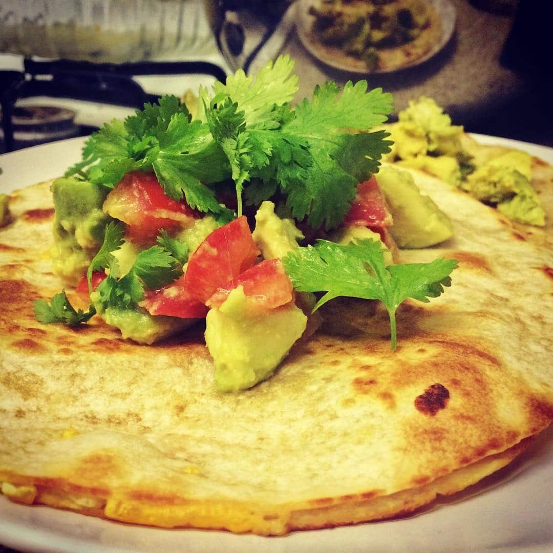 vegan quesadilla with tomatoes and avocado